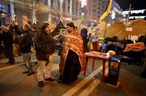 Priest on duty during Euromaidan, December 2013. Photographer: Ivan Bandura