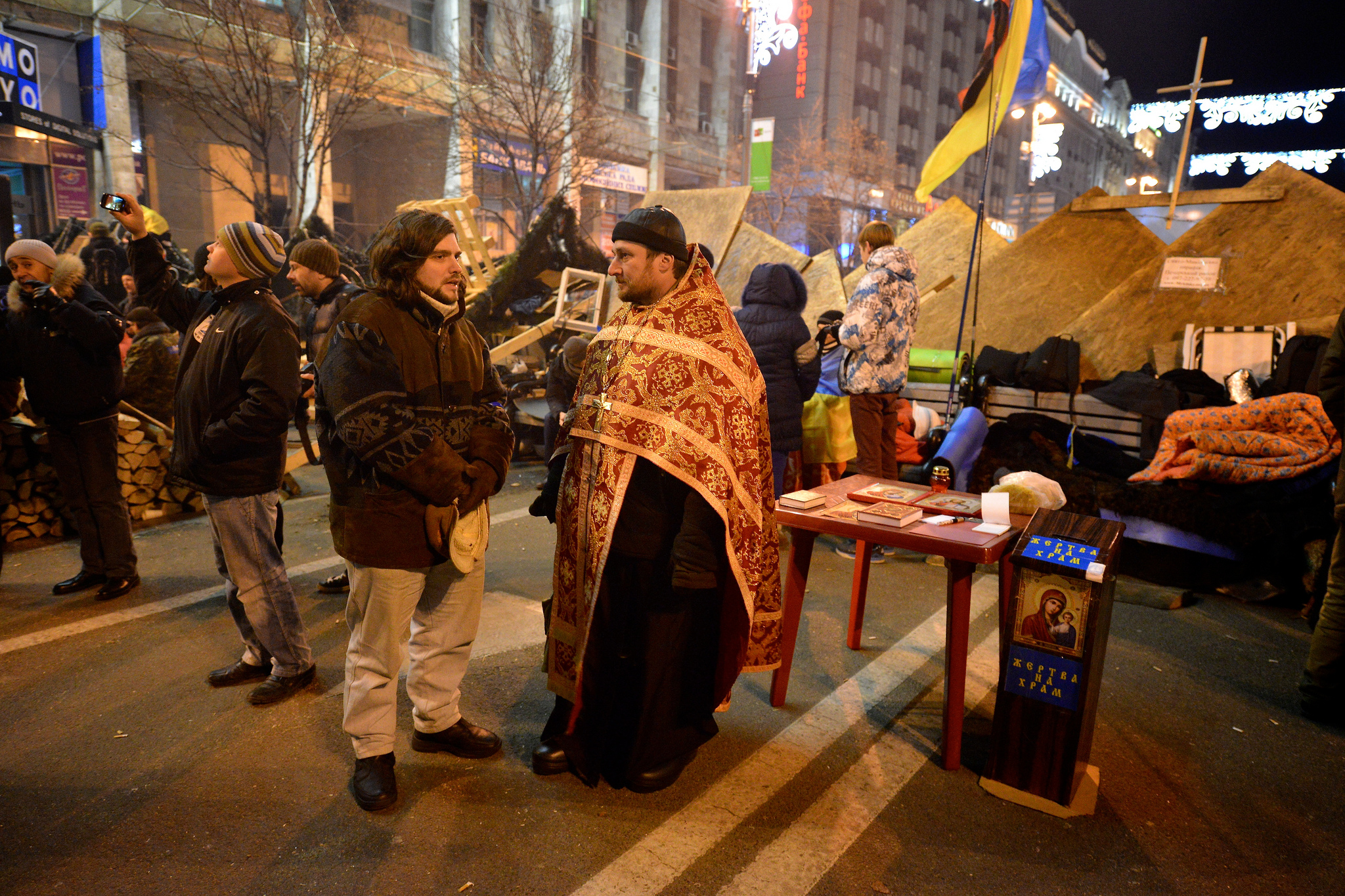 Priest on duty during Euromaidan, December 2013. Photographer: Ivan Bandura