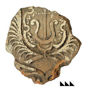 Broken ceramic heraldic stove tile found in the suburb of Ostrih in 2014. Baturyn Museum of Archaeology. Photo: T. Kerbut.
